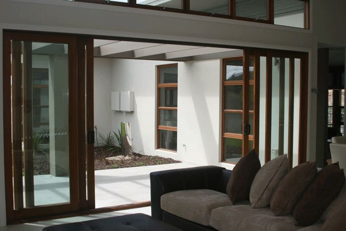 Meranti Timber Sliding Stacker Doors