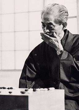 Yasunari KAWABATA, a Nobel Prize-winning novelist (1899~1972), playing Go (Japanese board game) at his home in Japan. 川端康成