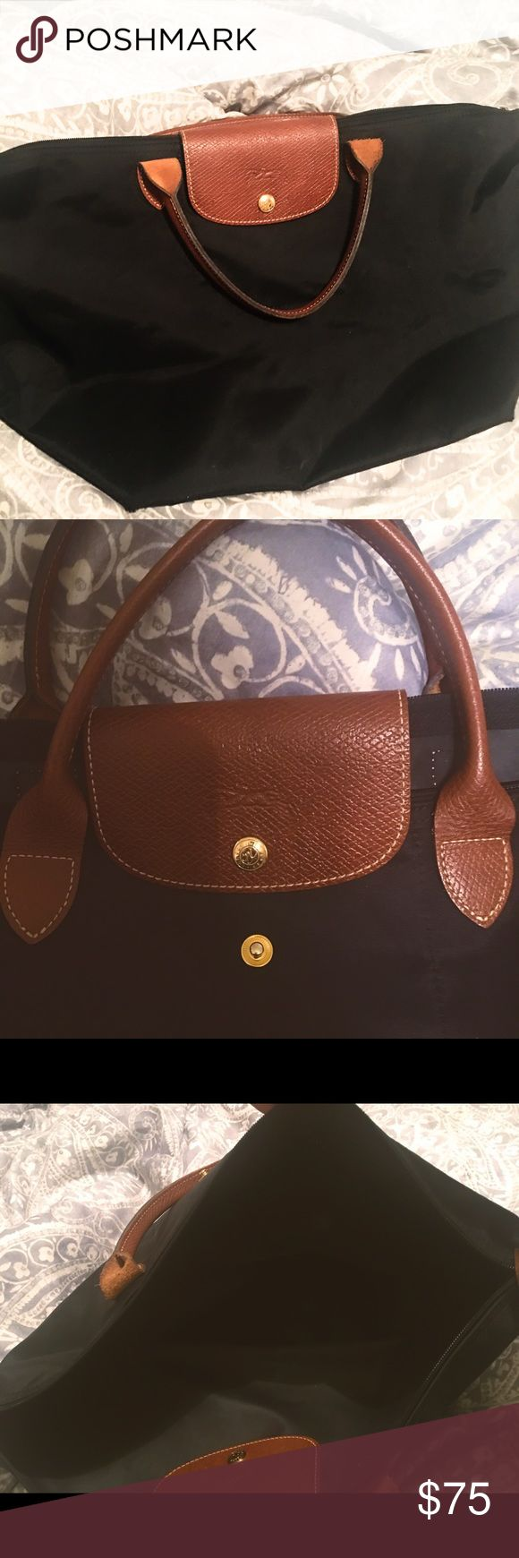 Large Black Longchamp Purse Good Condition Used a good amount but not distressed like heavily used Longchamps. Still has a lot of life left in it -also. I'm not going down on the price given the original price and how good of condition it's still in Longchamp Bags