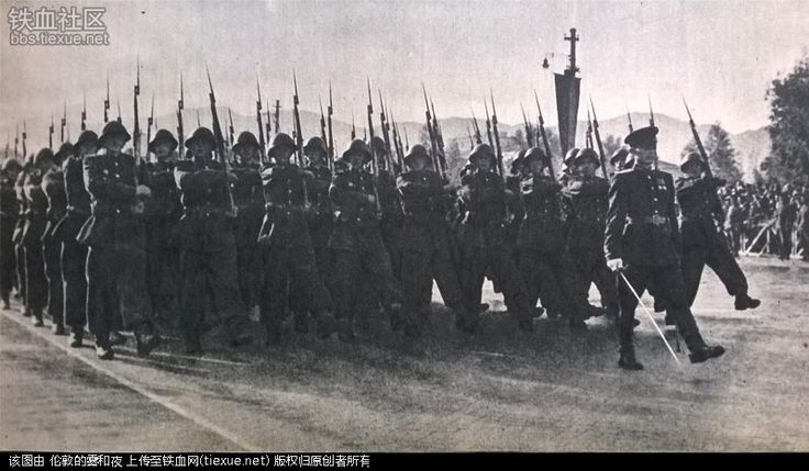 Officers and enlisted servicemen of the Albanian People's Army marching down Deshmoret e Kombit Boulevard at the 1952 Albanian National Day Parade.