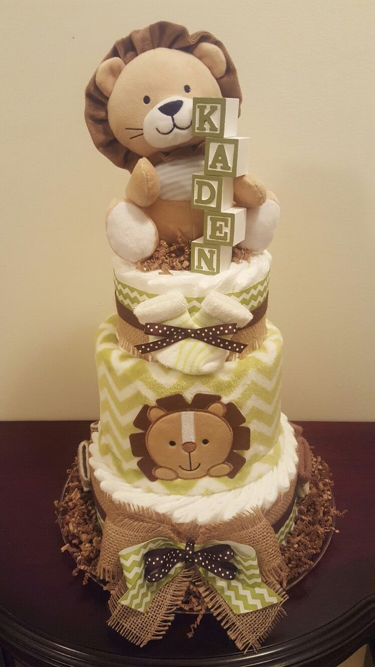 Lion diaper cake! Safari themed baby shower.  Diaper cake created by Kim Swinson-Simply Showers,  visit my Facebook page Simply Showers for more pics and orders.