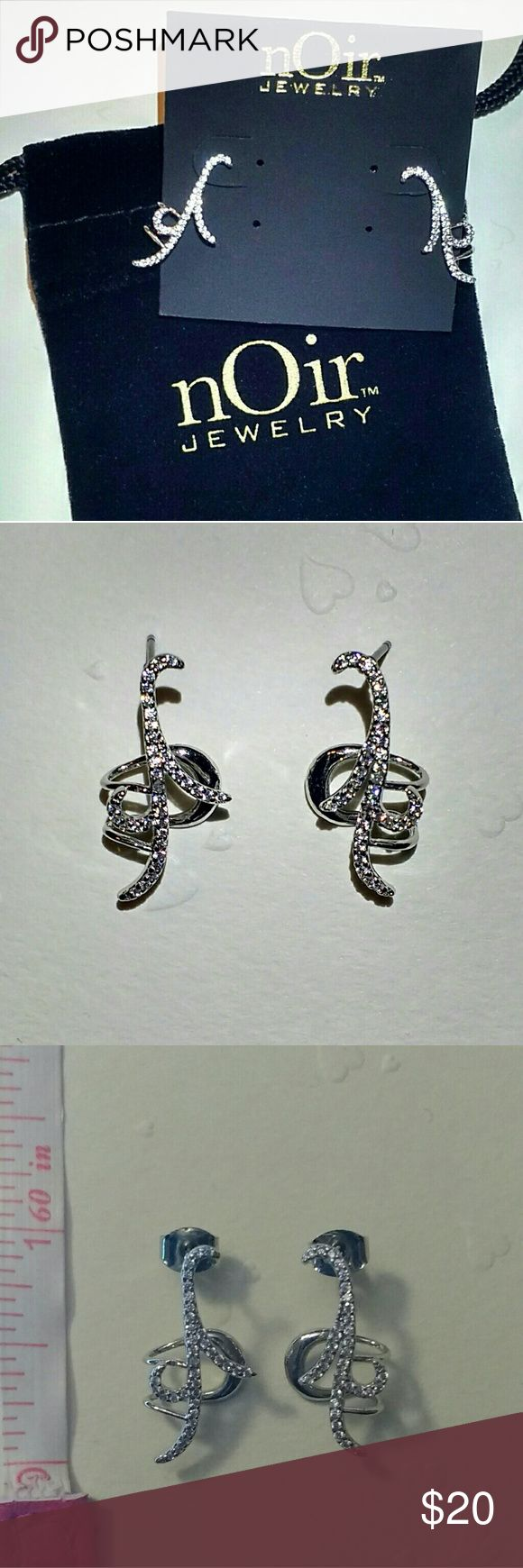 NWT Silver-tone cuff earrings NEW with tags, never worn.  Silver-tone cuff earrings with pierced post backing featuring cubic zirconia in swirling motif. !!! As seen on the pictures, the earrings are not completely identical !!! Fast shipping! nOir Jewelry Jewelry Earrings
