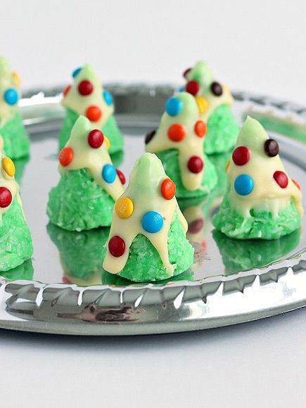 15 Super Creative Holiday Cookies That Are Surprisingly Easy | NO-BAKE CHRISTMAS TREES  | Not having to turn on the oven means less opportunity for error – and kids can help, too. These adorable little Christmas trees are bound with shredded coconut and require no flour (so they're gluten free, too!). Get the recipe HERE.