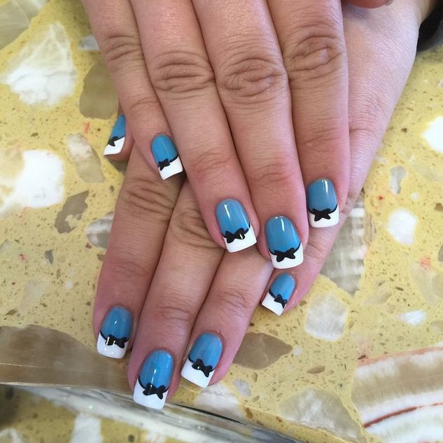 """Even adults will love this Disney nail art. If you feel like you're too old to wear bows in your hair, wear them on your nails instead. This prim and pretty manicure will make your friends """"all mad"""" with envy."""