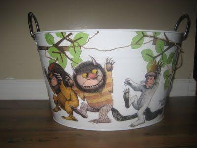 Mod Podge Children's book illustrations onto a bucket