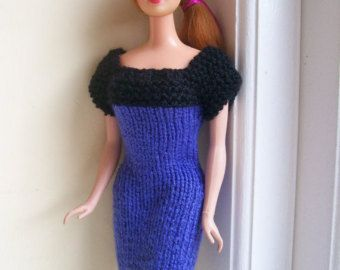 This smart dress is hand-knitted from fawn, navy blue and white yarn, and has horizontal stripes. It will look great on both vintage and modern Barbie shapes. It has no fastenings. Modelled by Norma Jean. Dress only - doll not included. All my handmade Barbie clothes are my own original designs and OOAK, and made in a pet-free and smoke-free home.