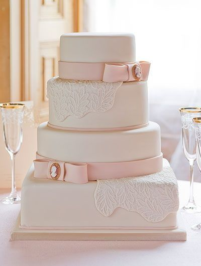 Elegant wedding cake with pale pink ribbons and cameos. Love that the bottom layer is square and the rest of the cake layers are round.