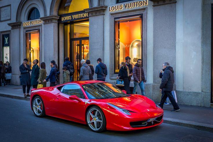 Red #Ferrari in front of #LouisVuitton on Via Montenapoleone. A classic cliché combination. #Milan #Italy #FashionDistrict