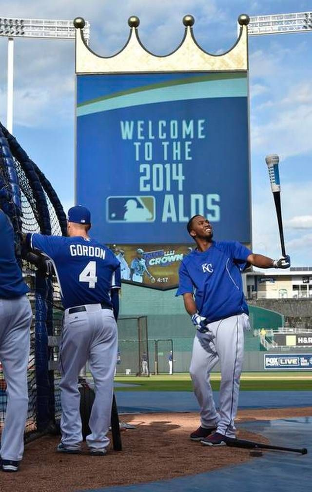 Kansas City Royals' Alcides Escobar (2) and Alex Gordon (4) take batting practice at Sunday's ALDS playoff baseball game on October 5, 2014 at Kauffman Stadium in Kansas City, MO.