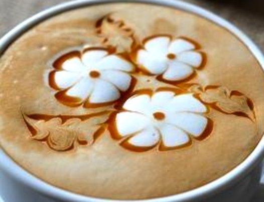 Flowers in my cup. Awesome coffee blog! http://theicedcoffeekid.com/
