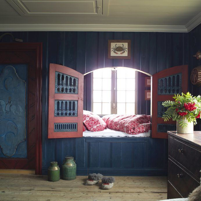 """Author Else Rønnevig created the special interiors in this compact cottage in Bergen, Norway. The house consists of one main living area. It has a sleeping alcove with two rustic doors in front, which were taken from an old cabinet. The traditional flax (linen) oil paints are solvent-free, and are made in the traditional colors """"Old Norwegian Blue"""" and """"English Red."""" Photo: Espen Grønli."""
