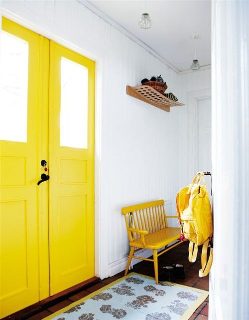 yellow interior door & bench by entry