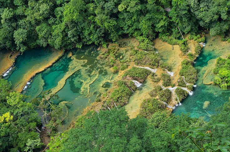 """Imagine the most beautiful crystal clear turquoise and emerald water you can. Pour that water into large cascading pools surrounded by limestone cliffs and lush green forest. This is Semuc Champey – one of the most stunning natural landscapes on earth."""