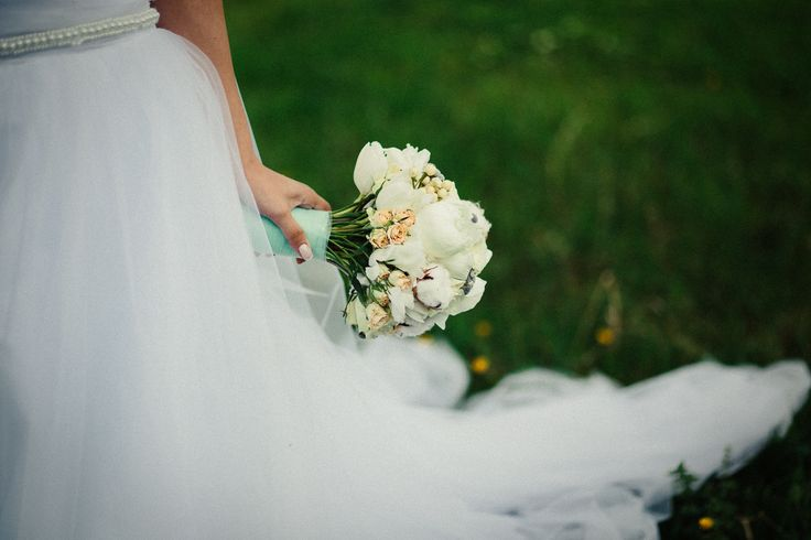 Roses, tulips, cotton flowers and peonies wedding bouquet