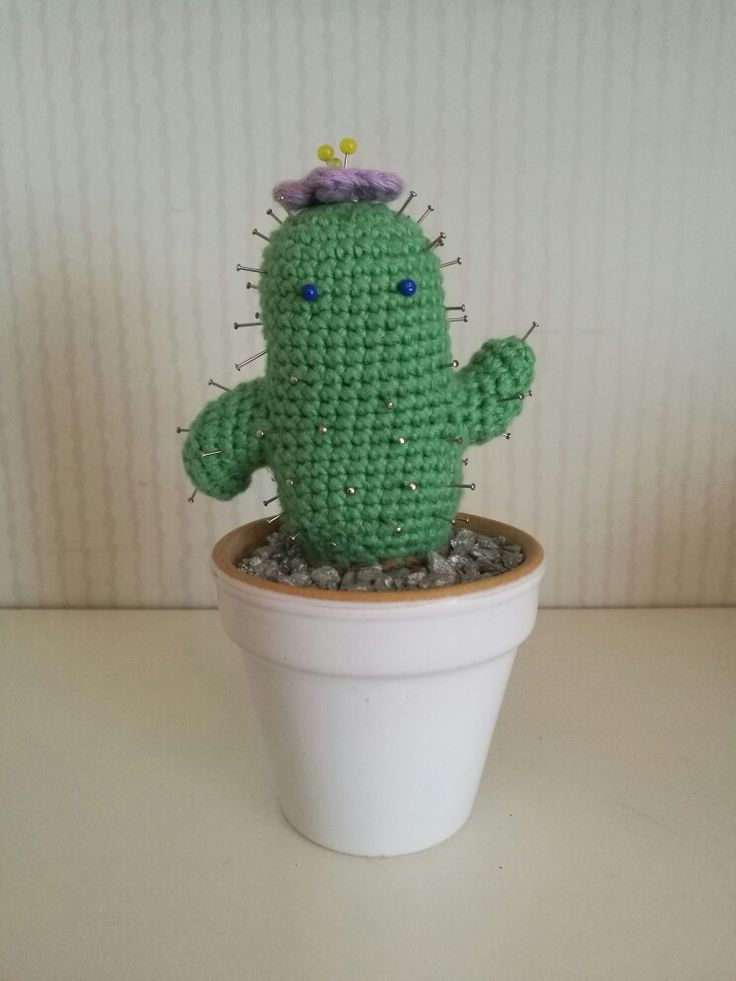 A needle pillow shaped like a cute little cactus  (about 7 cm tall)