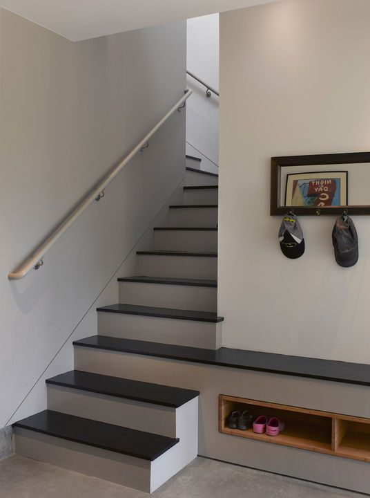 Built-in shelves tucked under a custombench offer an easy place to take off shoes andstow them in the garage-entry mudroom at thisSan Francisco residence.    This originally appeared in Park Street Renovation.