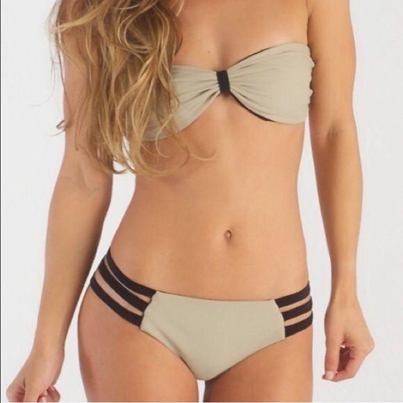 NWT🎉👙Reversible Swim Top in Nude/Black Reversible Britt Top in Nude / Black. **THIS IS A MEDIUM, BUT IT FITS LIKE A SMALL** # bikini # swim # bandeau # strapless # boho # beach # summer # mandalynn # victorias secret inspired # vs # two piece  80% Nylon 20% Spandex Fully lined Reversible Sliding tab Made in USA Mandalynn Swim Bikinis