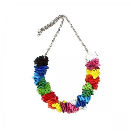 Necklace with accordion-shaped multicolored baloons. In this collection, the latex found its leading role and its final and durable destination as it could never happen in reality.