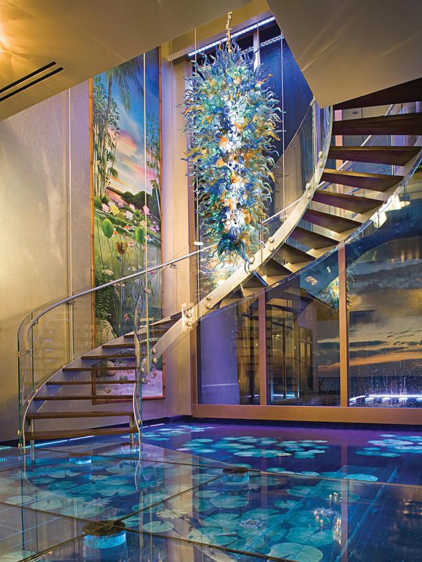 One-of-a kind foyer includes a Chihuly glass sculpture and  'water floors' (the water flows beneath clear glass).  HGTV Million Dollar Rooms Tour