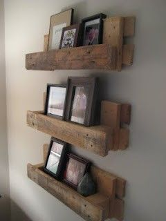 Hang Pictures with pallets. I would sand and stain these first but another great idea!