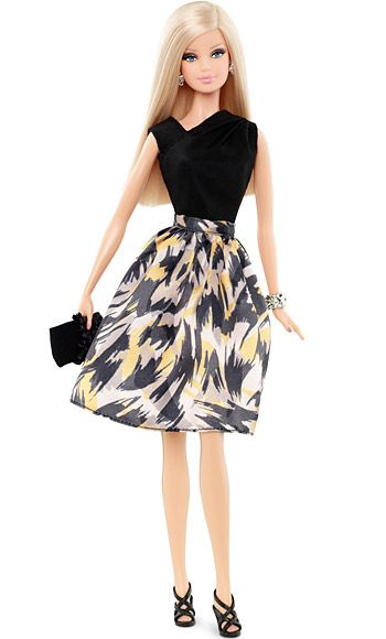 Barbie Gets a Tim Gunn Makeover: Exclusive First LookBarbie's Evening LookBarbie is ready for her night our with Ken! This $25 accessory pack comes with an asymmetrical black top, patterned skirt, strappy sandals, and sparkly jewelry. $25 at barbiecollector.com and Target stores in August.