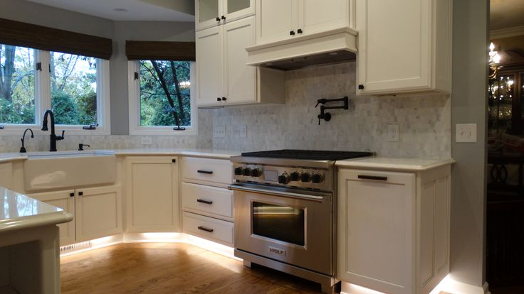 Farmhouse sink, insta hot pot filler at stove, toe kick accent lighting, stone tile backsplash