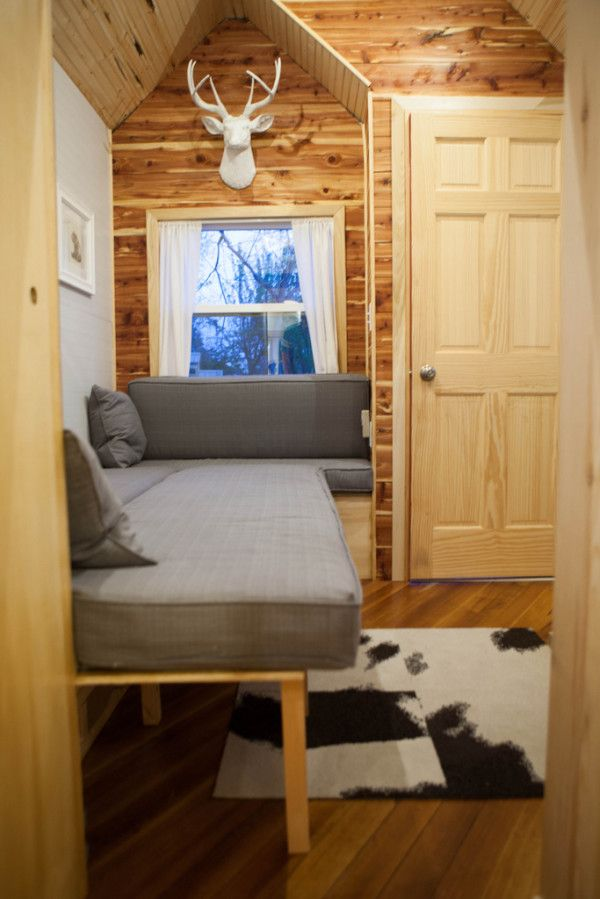 Jamisons Tiny House - Interior  i like that you could put storage under the couch