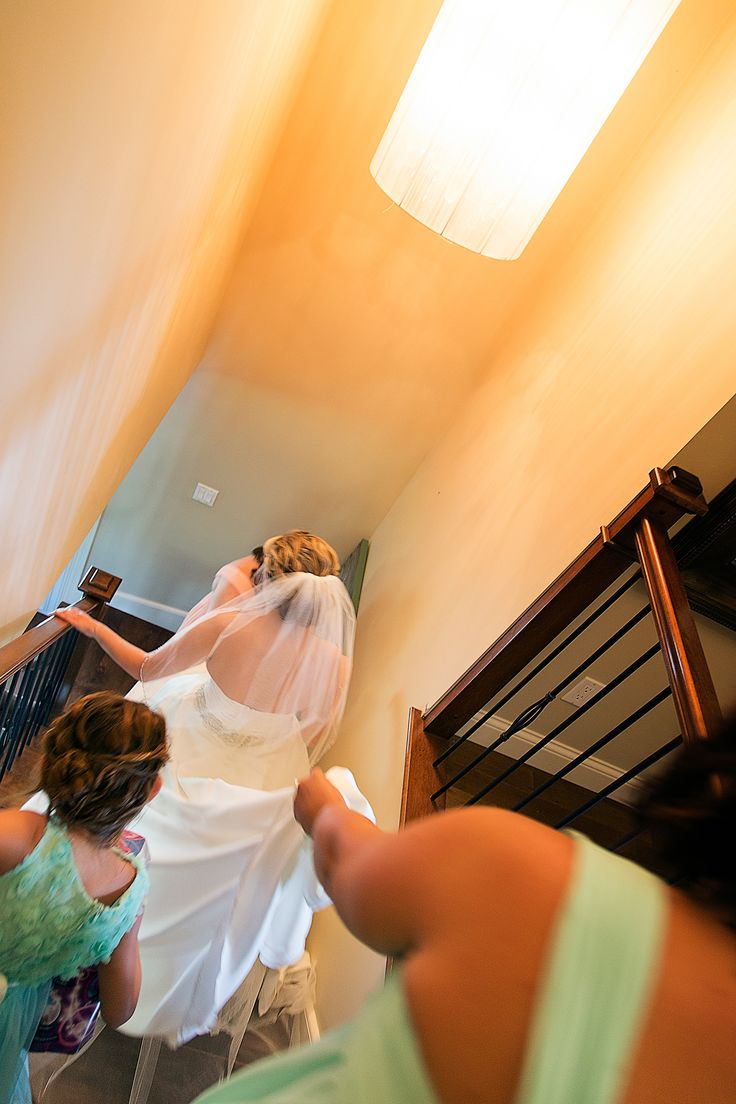 Bride walking downstairs getting ready to leave; Photo cred: Hillary McCormack Photography