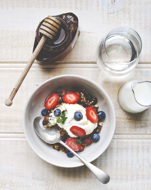 A healthy start breakfast granola with yogurt, blueberries, strawberries, and honey by Chantelle Grady. simple ingredients, simple recipe, ultra yum.