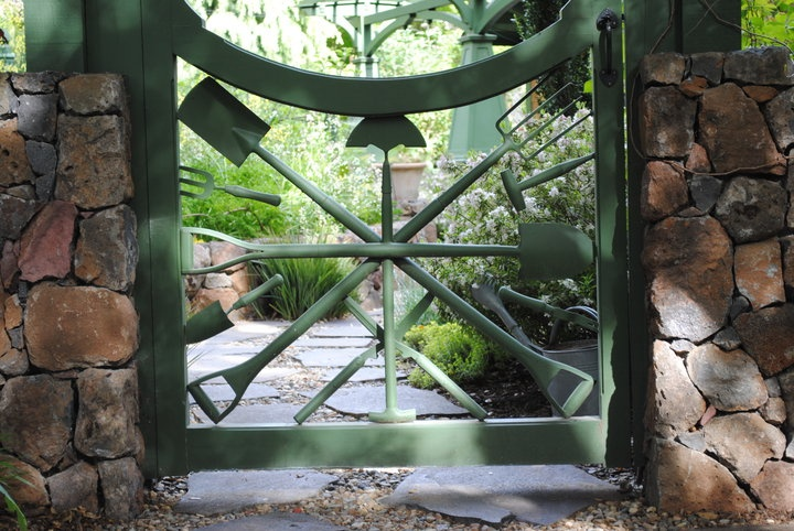 Garden gate made from old garden tools