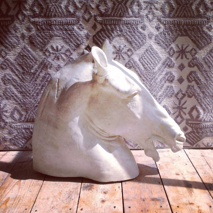 Our 1950s Italian horses head, based on a horse at the Parthenon stands proud against our St. Giovanna rug