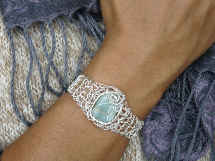 Crocheted bracelet made with silver plated wire (non-tarnish). The crystal is firmly hold with knitting wire technique.