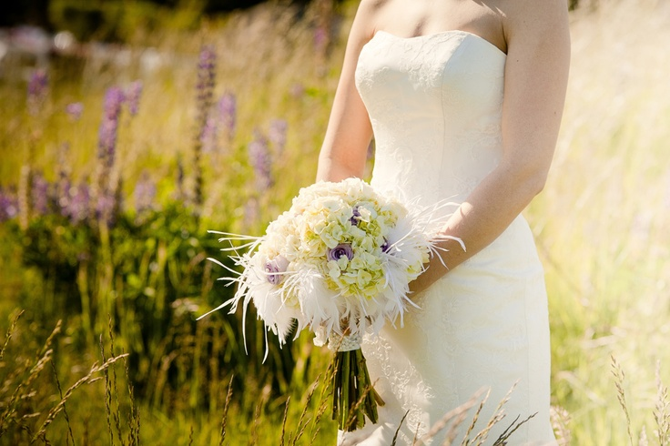 White hydrangea and lavender rose bouquet with white feathers