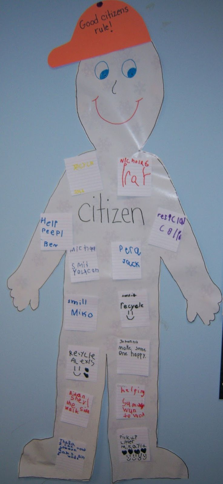 """Students """"sticky tabbed"""" discriptions of a good citizen.  She said next time she'd have all the shirts one color paper and the pants another."""