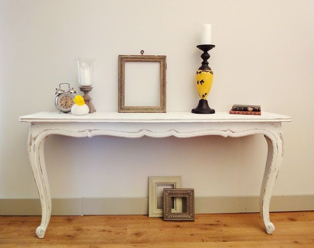 Make your own console table out of dining room table.  Very cool!