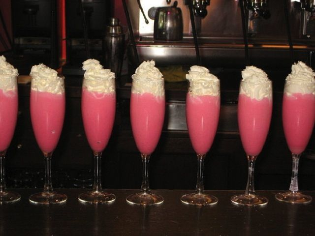 Pink Panties! Two frozen pink lemon aid, lots of vodka (can't taste vodka at all), blend with ice then top with whip cream.