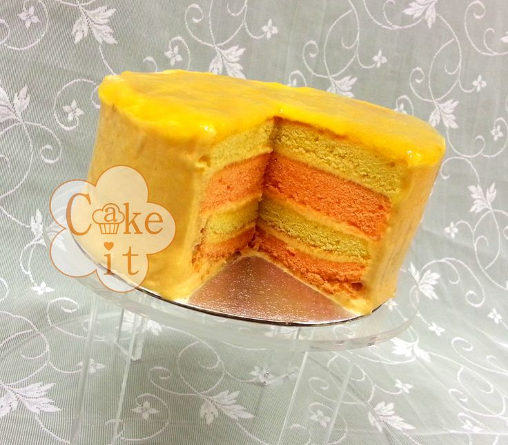 Lemon & tangerine sponge with mango buttercream and topped with sweet ...