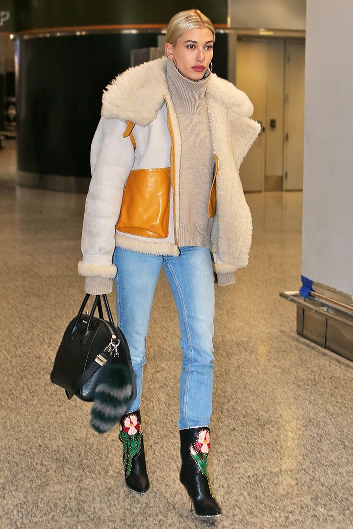 Hailey Baldwin just wore the season's most beautiful ankle boots to the airport. See the Gucci shoes for yourself here.