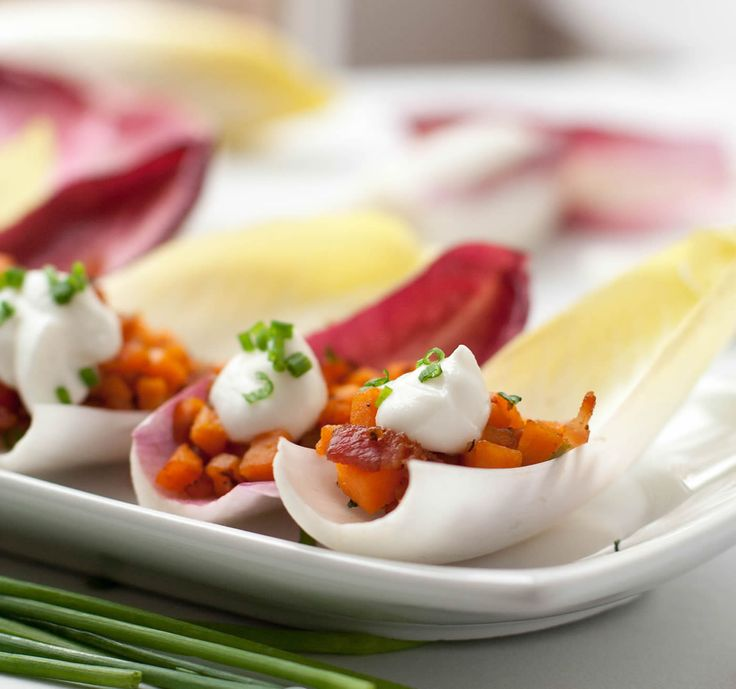 Endive Spears with Sweet Potato, Bacon and Chives. Topped with a little dollop of sour cream, it's an easy, yet impressive appetizer. A perfect little bite!