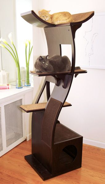 Lotus Cat Tower - A sleek, organic design, its Zen-like design blends symmetry, functionality, and minimalism into a beautiful, flowing cat tower. This design accents decors with modern flair or eclectic homes that have incorporated a minimalist aesthetic. From TheRefinedFeline.com