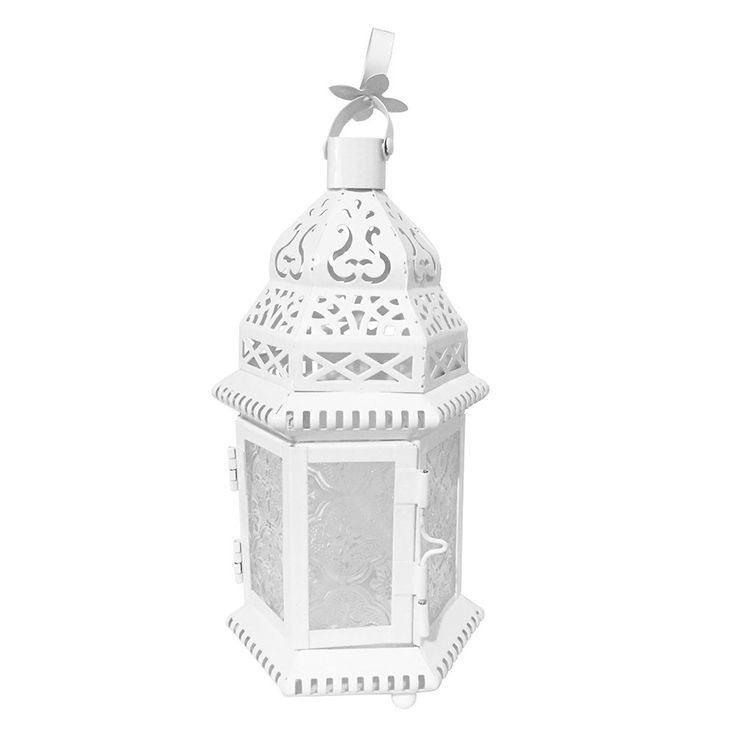"This small lantern is only about a hand high. Fits a votive or tealight candle. Two panel door has a 2 3/4"" x 3 1/4"" opening. 10 1/4"" high with hoop up. Embossed glass."
