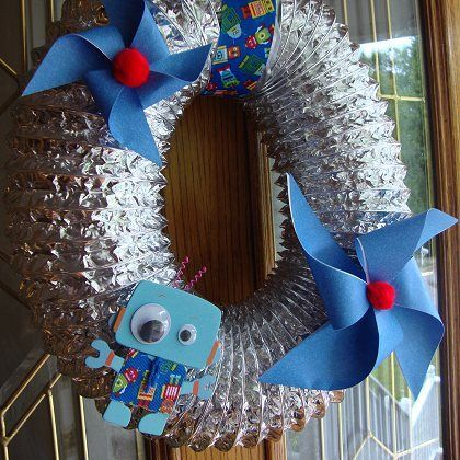 Space themed wreath made from a dryer vent.
