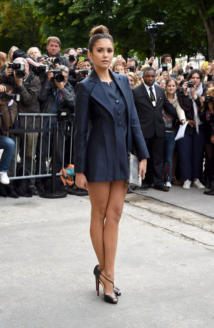 Pin for Later: 97 Reasons Why Nina Dobrev Will Be Just Fine Post-TVD  Nina stepped out in a structured navy look the the Chanel show during Paris Haute Couture Fashion Week for Fall 2014.