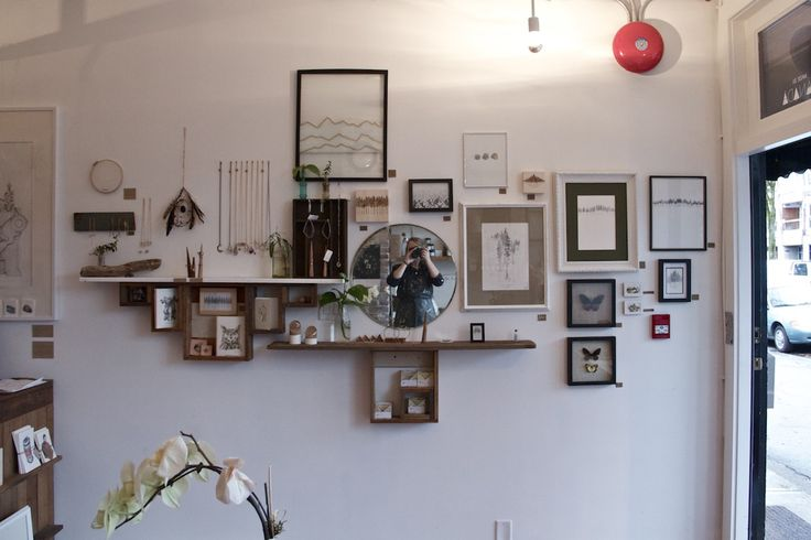 Salon-style wall in-progress at TROUT & CO. #salon #painting #drawing #frames