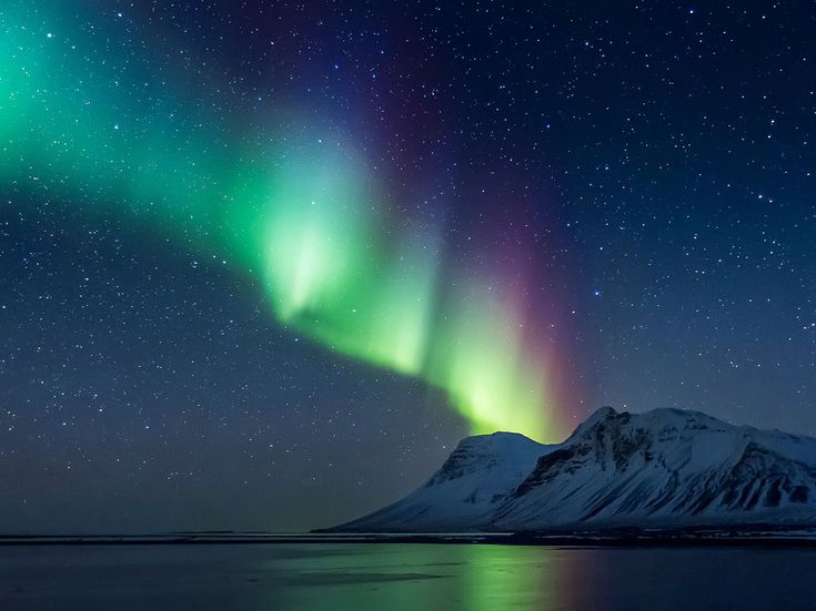 You can't beat photos of the Northern Lights. These are in Iceland.  30 Places to Visit Before You're 30 - Condé Nast Traveler