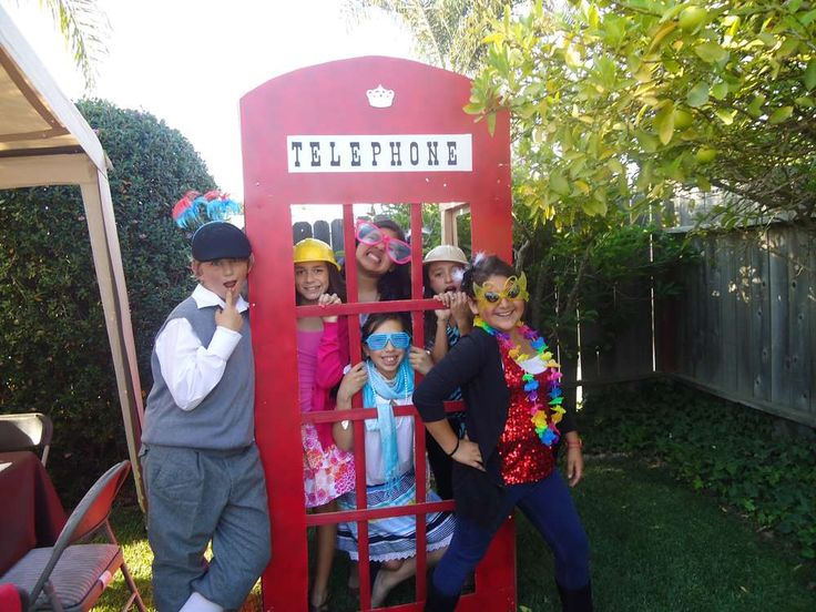 red English telephone booth cut out ~ super cute photo booth prop for a British-themed party! | via CatchMyParty.com