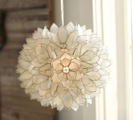 Love a capiz chandelier. We have one like this in our bedroom ❤️