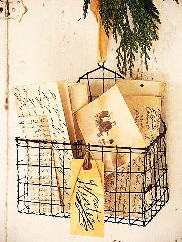 Vintage-White Christmas Decorating:   Simple holiday decorating touches bring Christmas to the quiet vintage style of this antique-white home. Christmas Card Holder:   A basket of photos and handwritten letters is marked with a tag that reads Winter. This wire basket is also handy for collecting incoming Christmas cards and letters.
