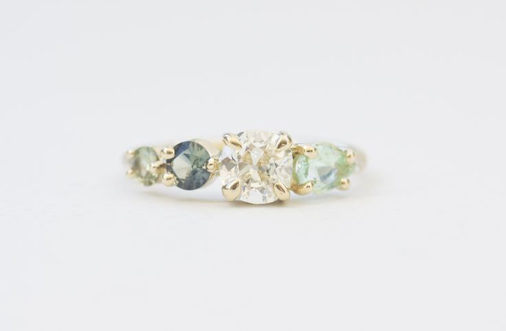 PARAIBA TOURMALINE, GREEN SAPPHIRE AND DIAMOND CLUSTER RING Image