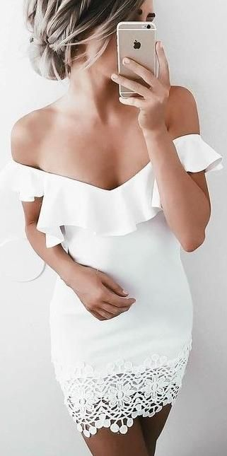 white off shoulders dress. ruffle detail. crochet trim. bodycon mini.